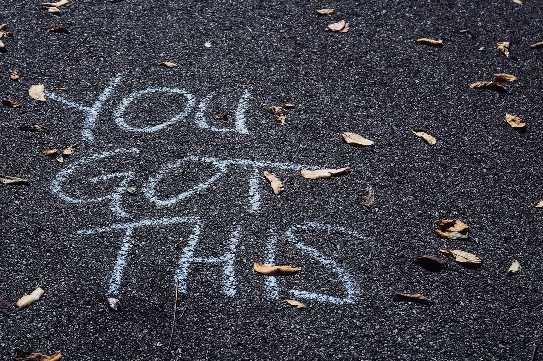 The words 'You Got This' written on tarmac